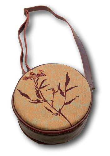 round sling handbag with leather